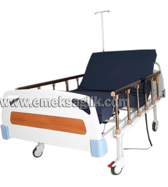 Pozisyonu ayarlanabilen, el kumandası ile hareket eden, ev tipi abs başlıklı 2 motorlu hasta karyolası.